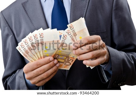 Man with euro banknotes - stock photo