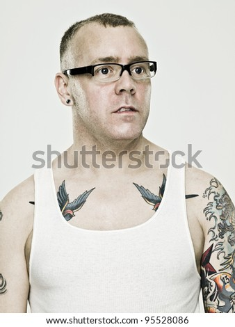 Man with eyeglasses and tattoos - IS098RC2E - stock photo