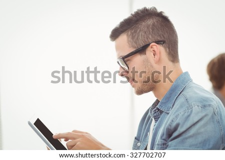 Man with eyeglasses using digital tablet at office - stock photo