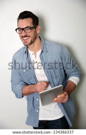 Man with eyeglasses using digital tablet, isolated - stock photo