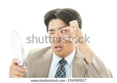 Man with eyestrain - stock photo