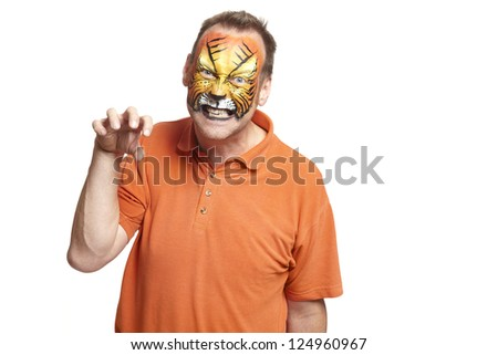 Man with face painting tiger growling on white background - stock photo