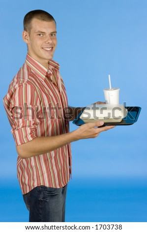 man with fast food meal - blue backgorund - stock photo
