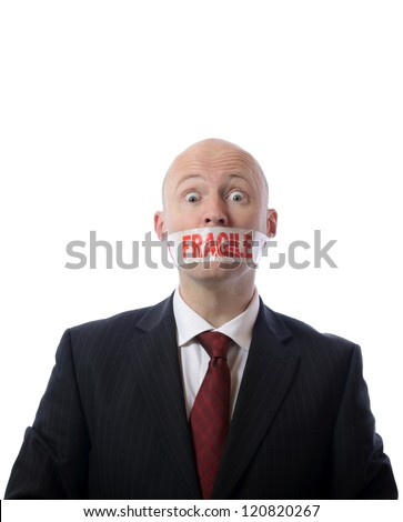 man with fragile tape over mouth concept of diplomacy or censorship isolated on white - stock photo