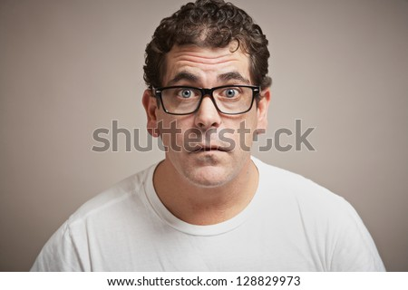 Man with glasses funny blank expression - stock photo