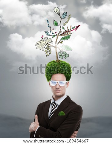 Man with green tree growing instead of hair. Environment friendly business concept - stock photo