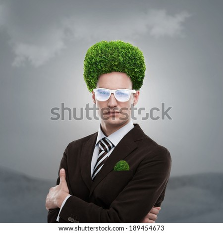 Man with greenery on his head. Loving nature and taking care of ecology concept - stock photo