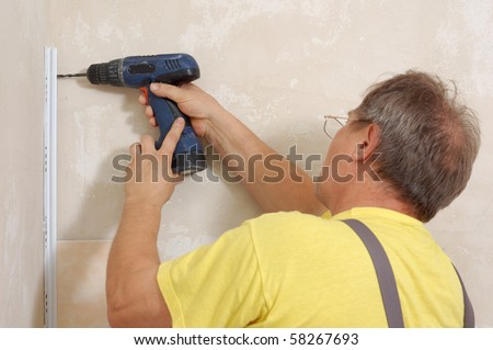 man with hand electric drill make renovation indoor - stock photo