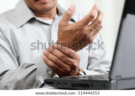 Man with hand pain.Close up. - stock photo