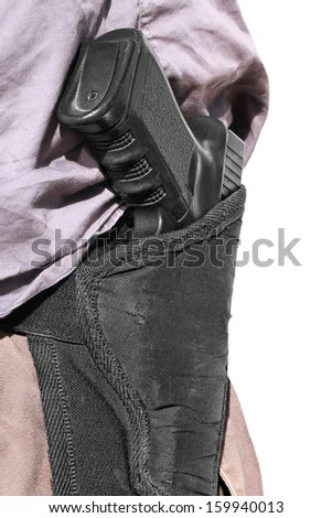 Man with handgun in old holster  - stock photo