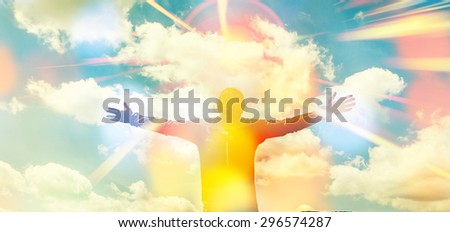 man with hands wide open in front of beautiful landscape,with sun rays ,happy and joy ,enjoying life,Successful Man - stock photo