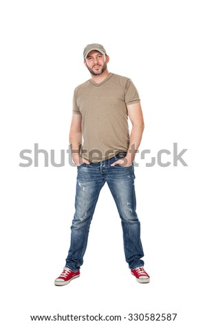 man with hat, t-shirt and jeans standing, isolated on white background - stock photo