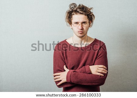 man with his arms folded - stock photo
