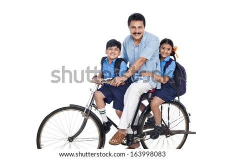 Man with his children on a bicycle - stock photo