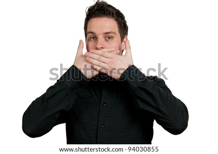 Man with his hands over his mouth and a shocked expression. - stock photo