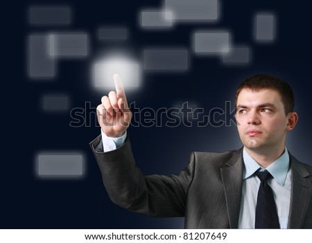 man with interface in futuristic interior - stock photo
