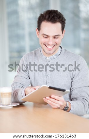 man with iPad - stock photo
