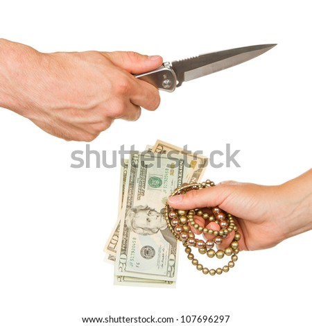 Man with knife threatening a woman to give her jewelry and money - stock photo