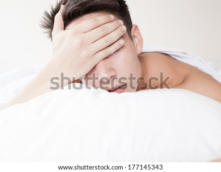 Man with lack of sleep - stock photo