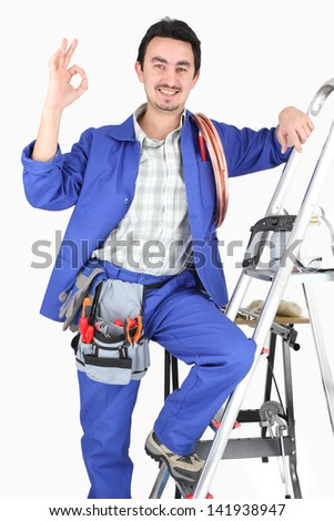 Man with ladder and plumbing tools - stock photo