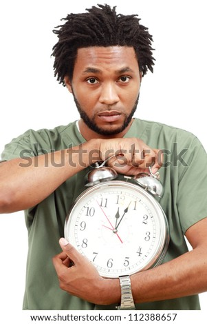 Man with large alarm clock - stock photo