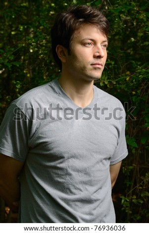 man with leafy background. - stock photo