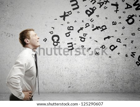 man with letters coming out of his mouth - stock photo