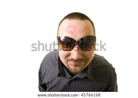 man with lipstick on his forehead - stock photo
