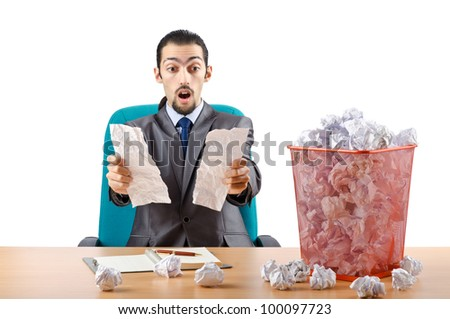 Man with lots of wasted paper - stock photo