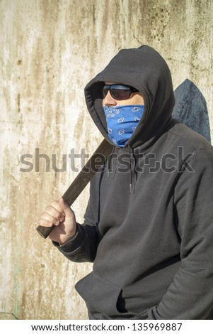 Man with mask and machete in hands - stock photo