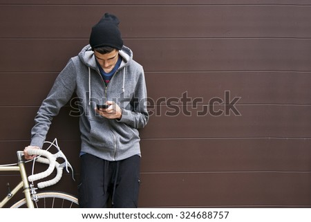 man with mobile phone and bicycle - stock photo