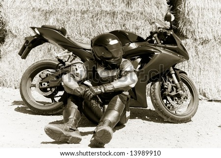 man with motorcycle - stock photo
