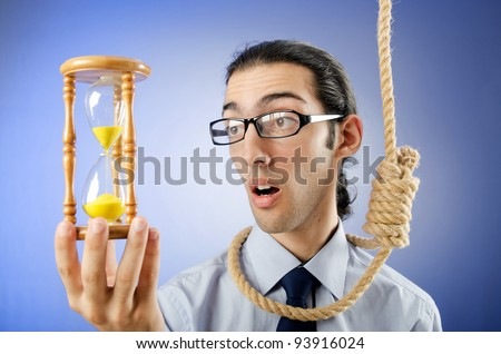 Man with noose around his neck - stock photo