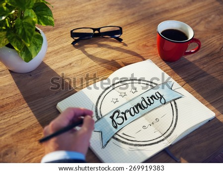 Man with Note Pad and Branding Concept - stock photo