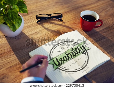 Man with Note Pad and Usability Concept - stock photo