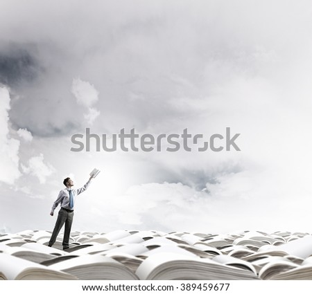 Man with opened book - stock photo