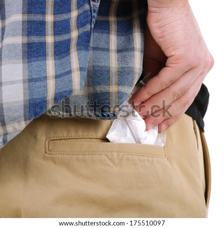 Man with packet of cocaine, close up, isolated on white background - stock photo