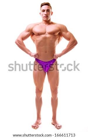 Man with perfect athletic body viewed from the front, lateral spread - stock photo