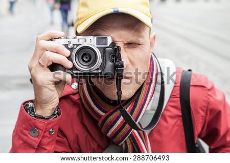 Man with photo camera portrait - stock photo
