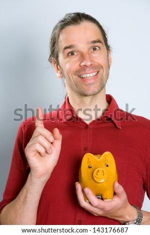 man with piggy bank - stock photo