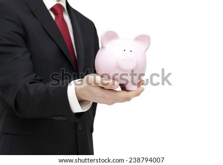 Man with piggy bank in hand. Clipping path included. - stock photo