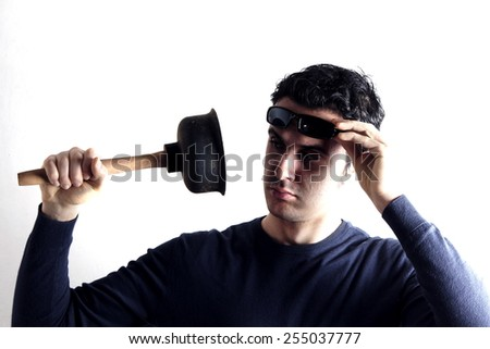 Man with plunger  - stock photo