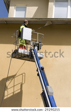 Man with pressure washer - stock photo