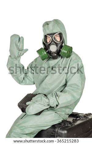 Man with protective mask and protective clothes isolated on white studio background. - stock photo