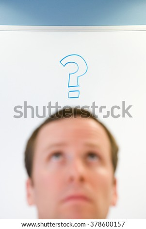 Man with question mark above his head - stock photo