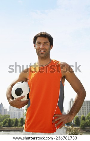Man with Soccer Ball - stock photo