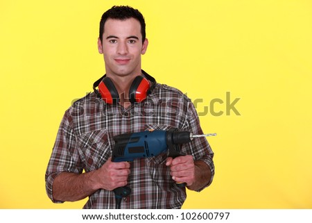 Man with soundproof earmuffs - stock photo