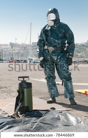 man with special ebola and virus dress or atomic contamination - stock photo