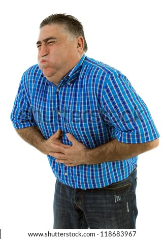 Man with stomach pains and with his hands clutching his gut - stock photo