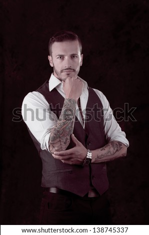 man with stylish suit and tattoos - stock photo